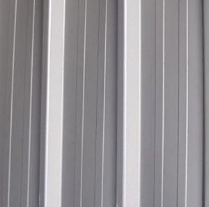 Tôle nervurée TPG profilées sur-mesure jusqu'à 14 mètres. Existe en 16 teintes.